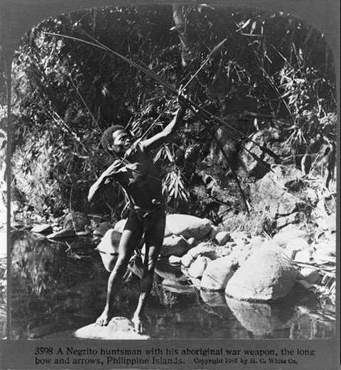 A Negrito huntsman with his Aboriginal War Weapon, the Long Bow and Arrows, Philippine Islands