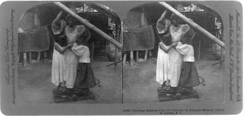 Helping Mama Iron the Clothes—a Filipino Method, Island of Luzon, P.I.